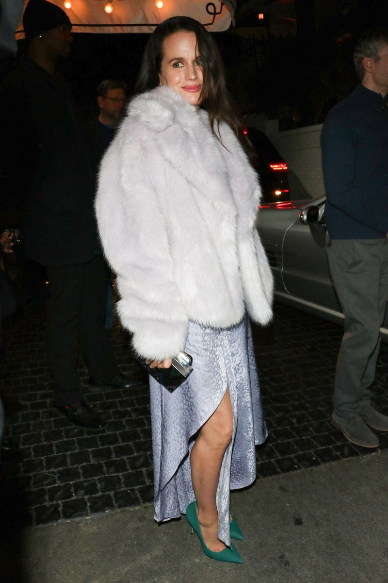 Elizabeth Reaser carries the 'Ciggones' clutch in silver to the W Magazine Party at Chateau Marmont