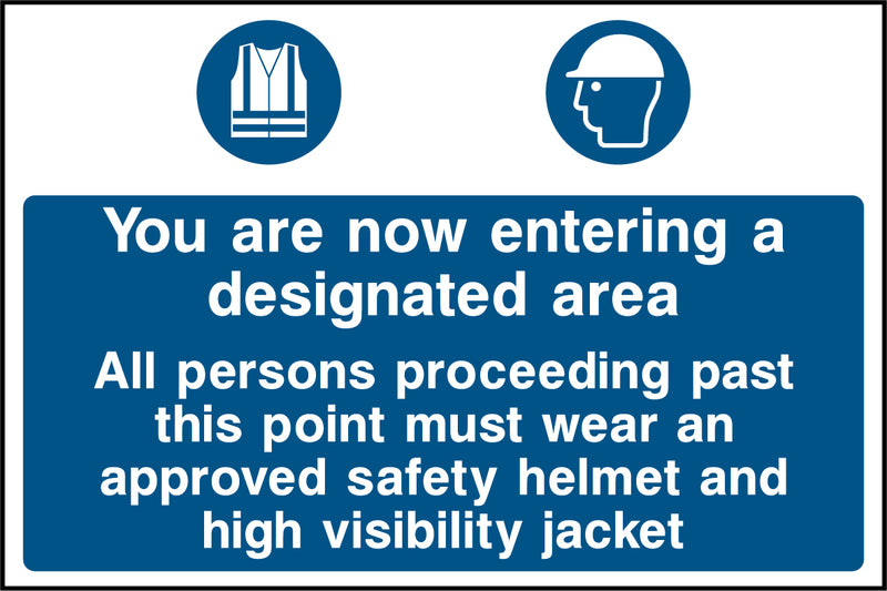 """You are now entering a designated area. All persons proceeding past this point must wear an approved safety helmet and high visibility jacket."" Sign"