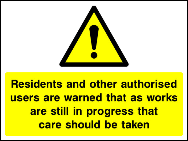 """Residents and other authorised users are warned that as works are still in progress that care should be taken."" Sign"