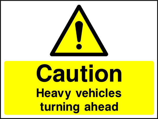 """Caution. Heavy vehicles turning ahead."" Sign"