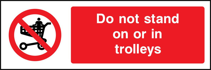Do not stand on or in trolleys. Sign