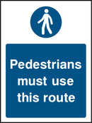 """Pedestrians must use this route."" Sign"