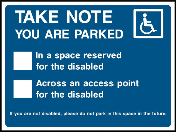 Parked in disabled spot or across disabled access point. Sticker