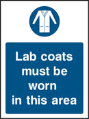 Lab coats must be worn in this area. Sign