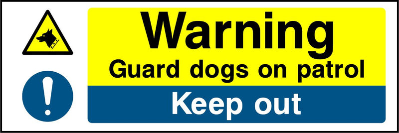 Warning. Guard dogs on patrol. Keep out. Sign