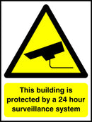 This building is protected by a 24 hour surveilance system. Sign