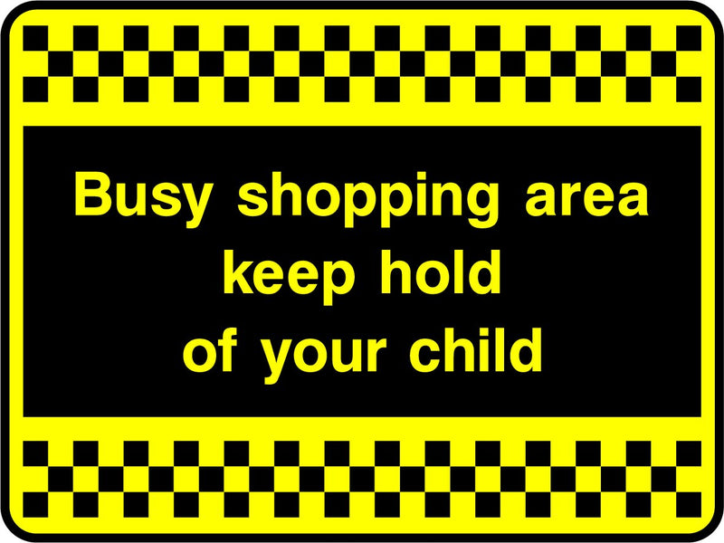 Busy shopping area, keep hold of your child. Sign