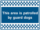 This area is patrolled by guard dogs. Sign