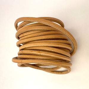 "1/4"" Round Leather Rope by the Foot"