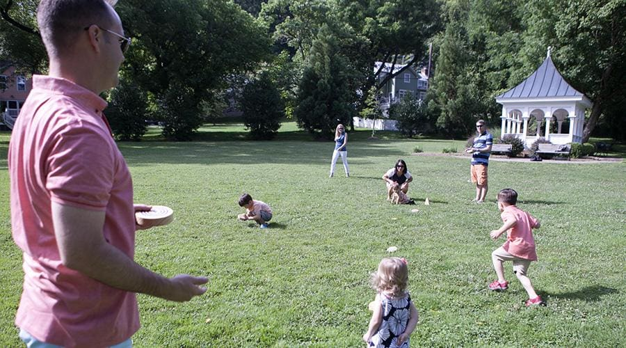 a group of people playing frisbee in a park
