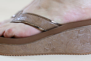 Very Volatile Embossed Tan Wedge