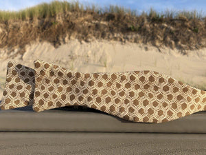 Brown bow tie with white tangled hexagon patterns