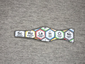 White bow tie with periodic table elements in colorful hexagons
