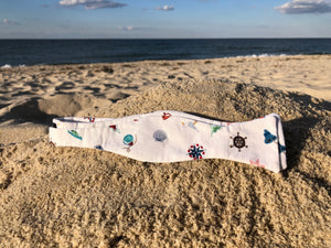 White bow tie miscellaneously colored with nautical decorations