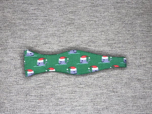 Green bowtie with grey whales wearing santa hats
