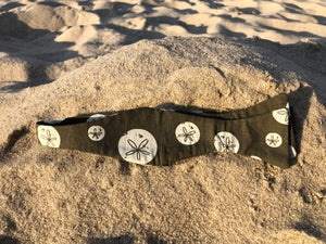Brownish olive bow tie with white sand dollars