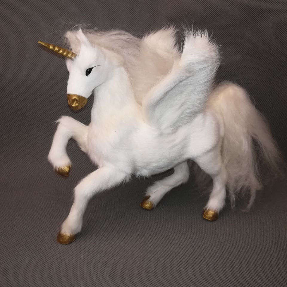 What dreams are made of...Your own 7 in x 9 in white unicorn Decor. Beautiful quality prepared hard model,polyethylene&fur unicorn with wings