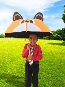 boy holding kids umbrella outside