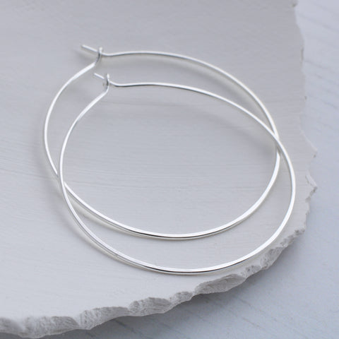 Medium Round Thin silver hoop earrings