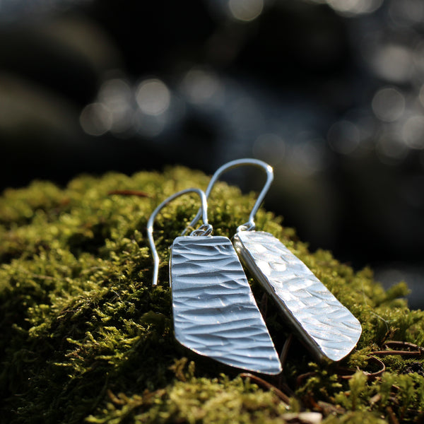River collection silver dangle earrings outdoors