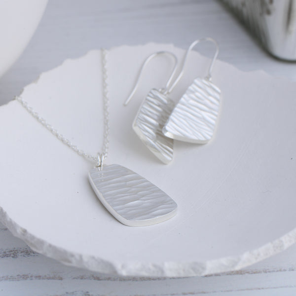River collection silver dangle earrings with matching necklace