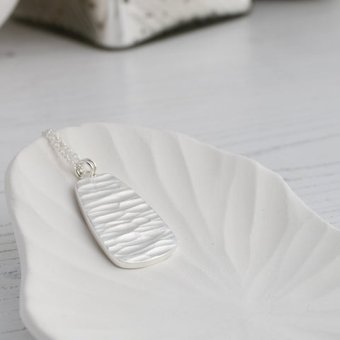 river collection carved silver pendant