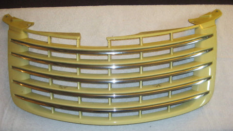 07 PT CRUISER FRONT UPPER GRILLE PASTEL YELLOW IN COLOR