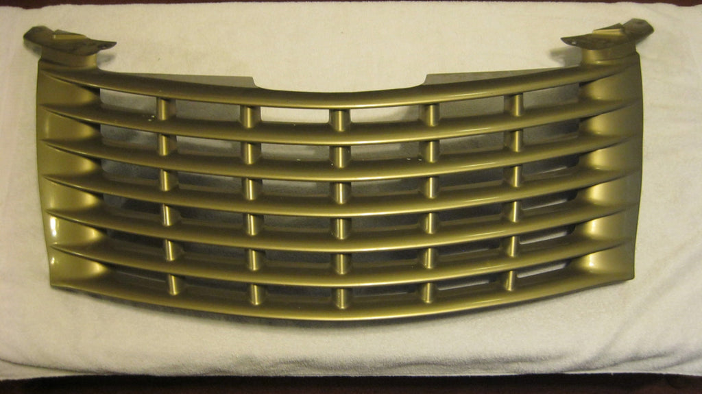 01-05 PT CRUISER FRONT UPPER GRILLE LIGHT ALMOND IN COLOR --- PNT CODE---PKJ