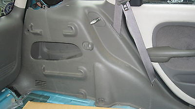 01-05 PT CRUISER DRIVERS SIDE REAR QUARTER PLACTIC TRIM- GRAY - OEM