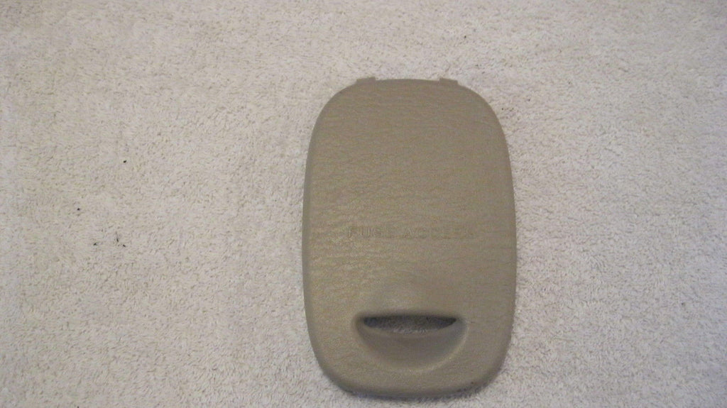 01-05 PT CRUISER DRIVER FUSE BOX COVER--- TAN IN COLOR -- OEM