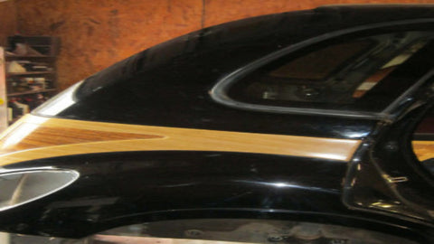 02 - 05 PT CRUISER REAR PASSENGERS SIDE QUARTER SUPPORT PANEL WITH WOODGRAIN - BLACK IN COLOR--- OEM