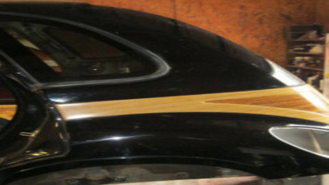 02 - 05 PT CRUISER REAR DRIVERS SIDE QUARTER SUPPORT PANEL WITH WOODGRAIN - BLACK IN COLOR--- OEM