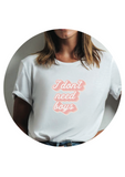 "girl wearing ""I don't need boys"" white t-shirt"