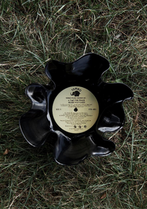 Handmade Vinyl Bowl being displayed on grass