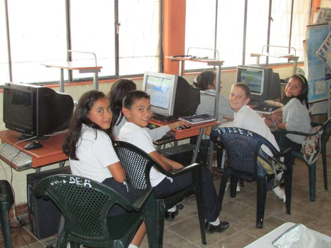 Our 11 year old son sitting in the computer classroom with his classmates in the Vilcabamba elementary school
