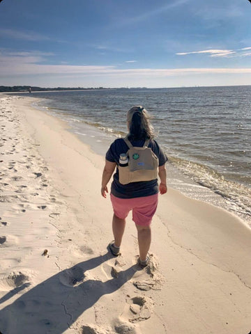 One of my customers is wearing her backpack on the beach