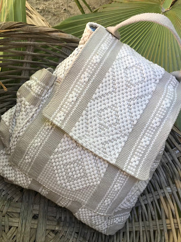 This shows the earlier artisanal version of the exact same backpack, but hand woven in Oaxaca, Mexico by master-weavers. A work of art in beige and kaki. It is available on another website.