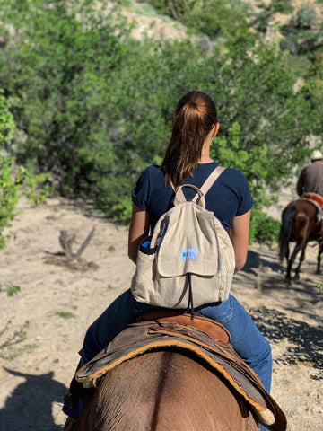 horse riding wearing the hemp multi pocket backpack, very nice feeling