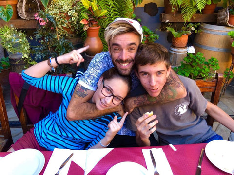 Three of my kids hugging at a restaurant in Tenerife