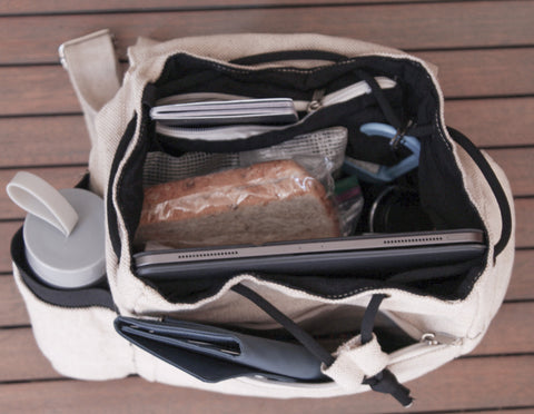 This photo shows how to pack the hemp backpack full, with the iPad Pro against the front side of the backpack