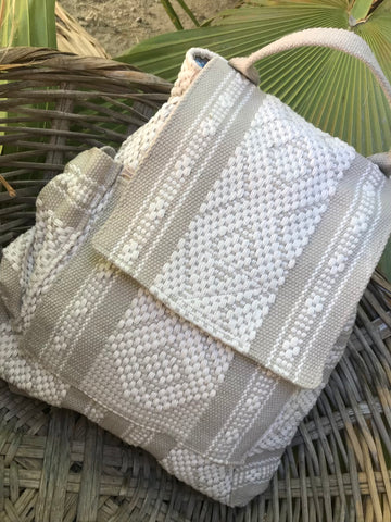 This shows the Mexican hand woven version of the GoApe backpack. It's beige with geometrical designs in kaki. A real work of art.