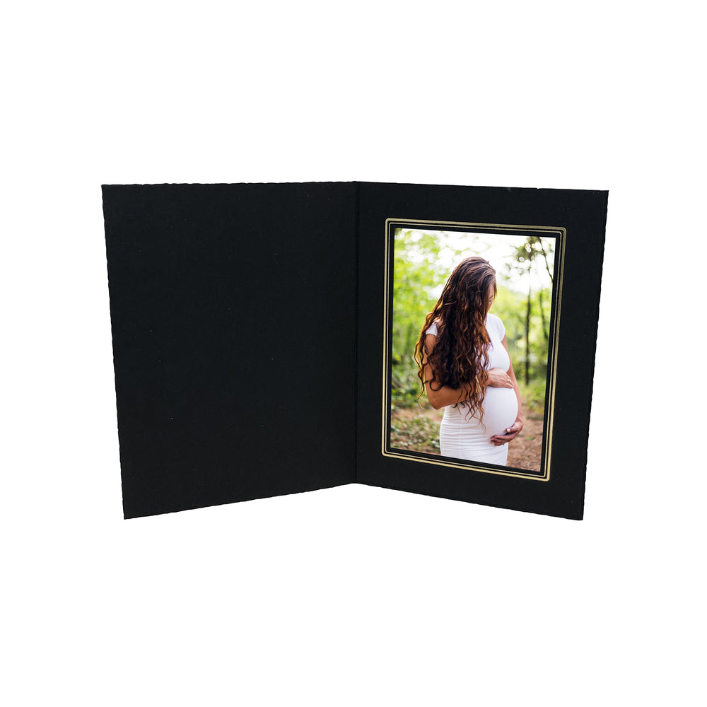 Black Smooth Deckled Edge Folder Series frames with gold trim in vertical orientation
