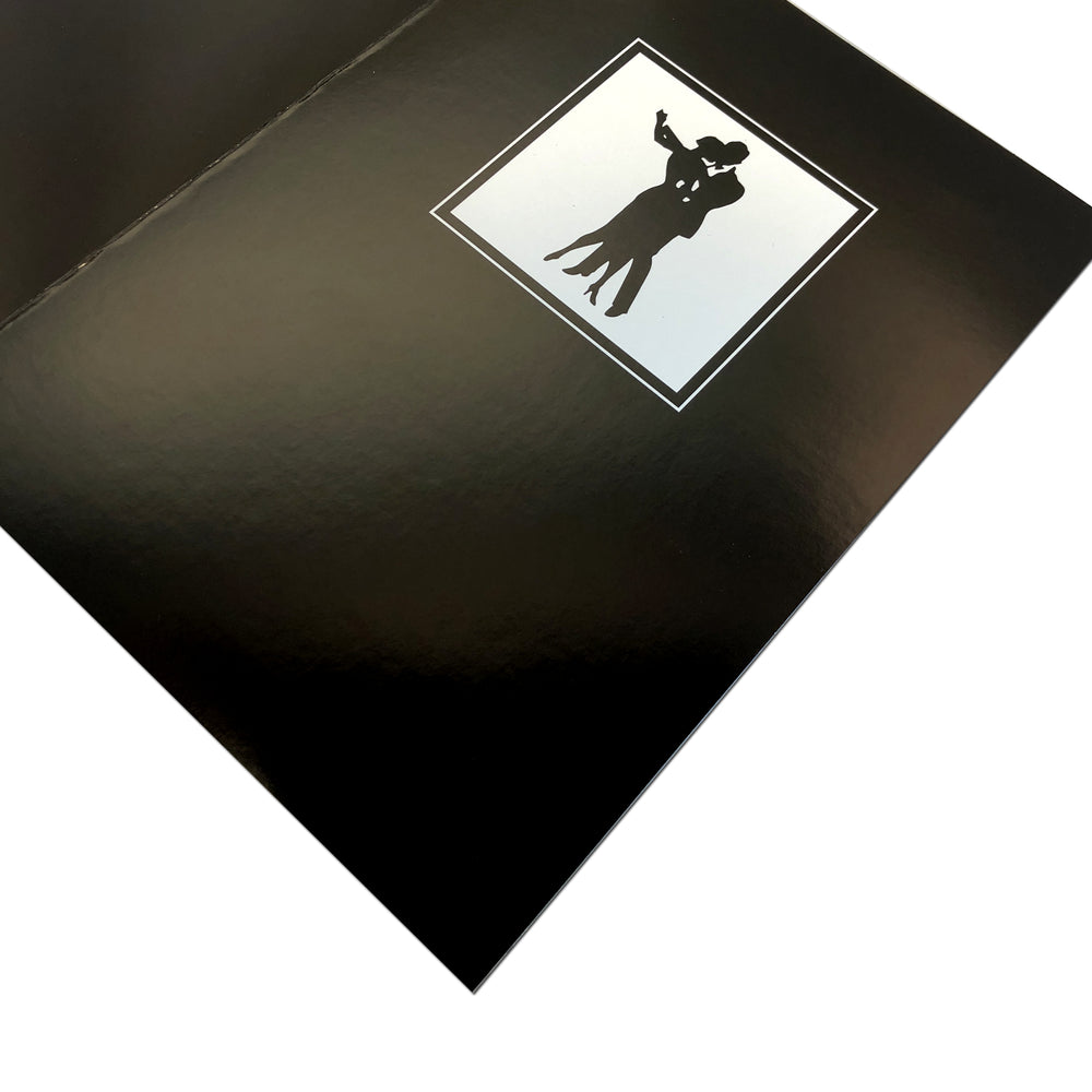 Black Waltz Folder frames with silhouette of a couple dancing on the front cover