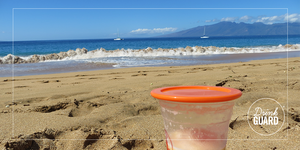 drinking glass cover at the beach