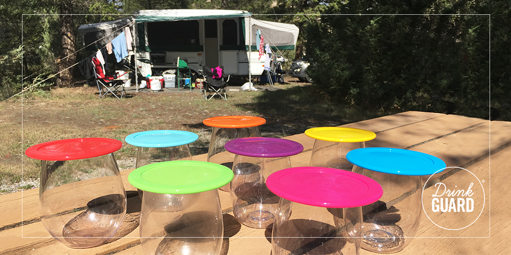 drinking glass lids at a campsite