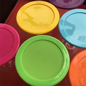 various coloured wine glass lids