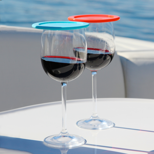 two wine glasses with lids