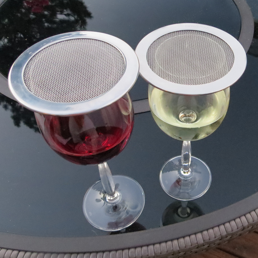 Wine glass lids display stacked and on a wine glass