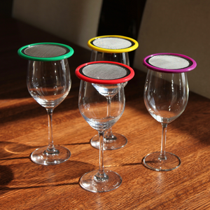 wine glasses with various coloured lids