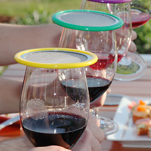 patio coloured wine glass lids on red wine glasses